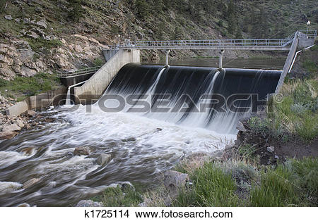 Stock Photo of concrete, gravity dam on a mountain river k1725114.