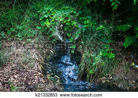 Stock Photo of waste water pipe or drainage polluting environment.