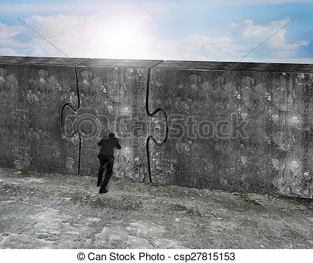 Stock Images of Man pushing huge puzzle door of concrete wall with.