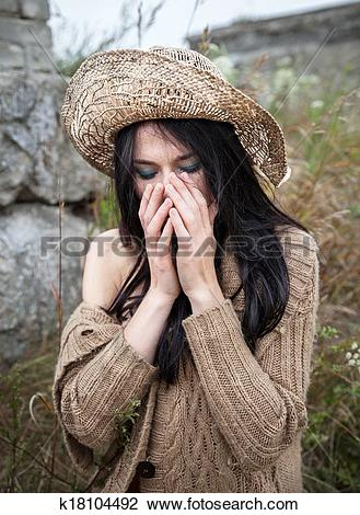 Stock Photo of girl against background of nature and old concrete.