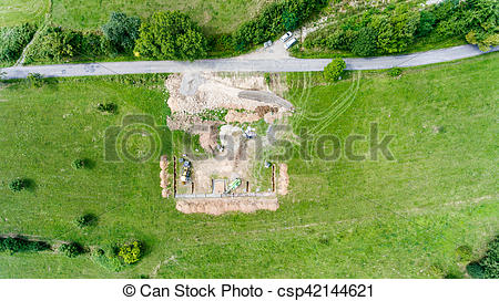 Stock Photo of Construction site. Building concrete foundation for.