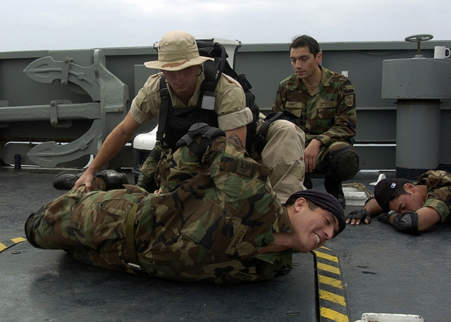 Stock Photo of Navy Sailors Conducting Visit, Board, Search and.
