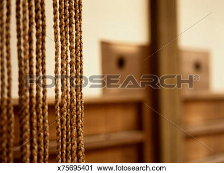 Stock Photography of Detail of a Nawa Noren in an Entrance.