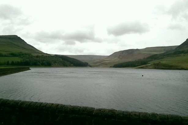 Police appeal to identify walker found dead near Oldham reservoir.