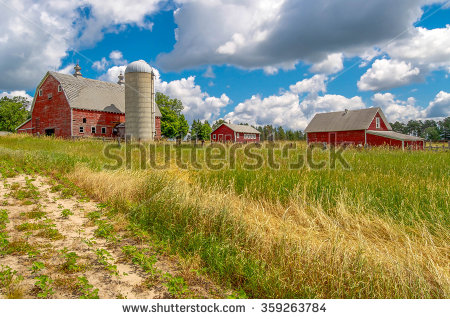 Clouds Over A Neglected Farm In Central Minnesota. Stock Photo.