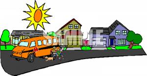 Free Clipart Image: A School Bus Driving Through a Neighborhood.