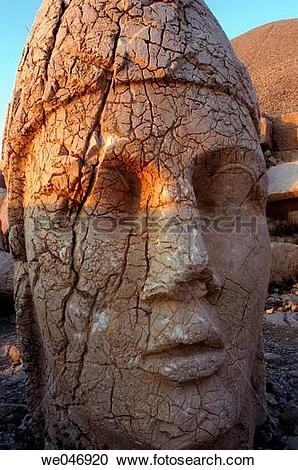 Stock Photography of Colossal statue head at summit of Mount.
