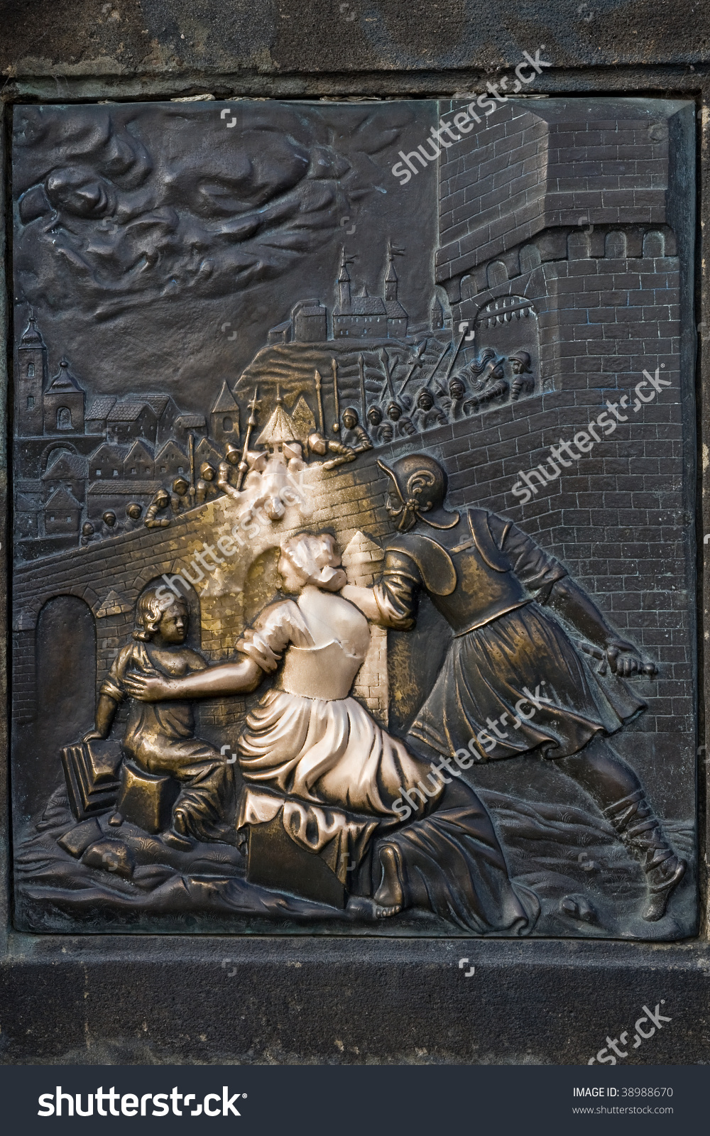 An Old Relief Below The Statue Of St. John Of Nepomuk On Charles.