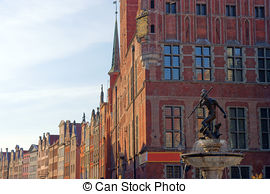 Pictures of Neptune fountain with pigeon on the trident in Gdansk.