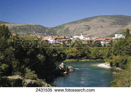 Stock Image of Neretva river and residential homes; Mostar, Bosnia.