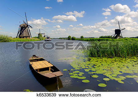 Stock Photograph of Windmill landscape at Kinderdijk The.