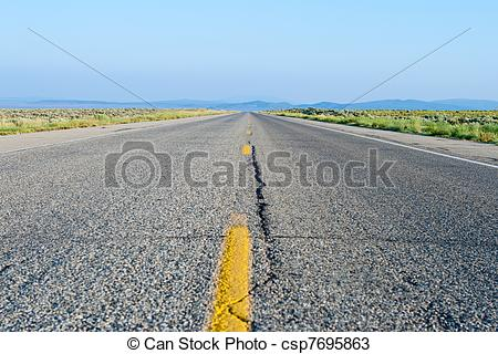 Stock Photos of Two Lane Road Crack Flat Desert New Mexico.