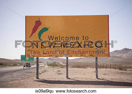 Stock Images of Road sign and highway, New Mexico State Line, USA.