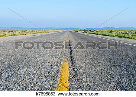 Stock Photo of Two Lane Road Crack Flat Desert New Mexico k7695863.