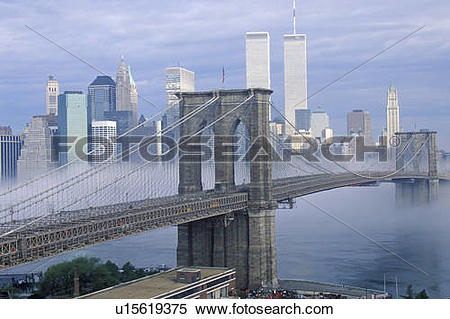 Stock Image of Morning fog over the Brooklyn Bridge looking into.