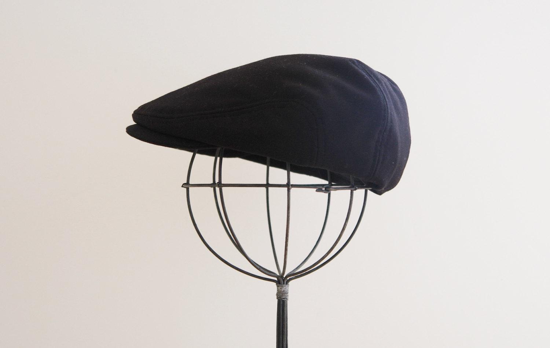 Newsboy hat.