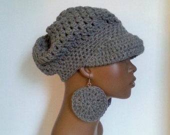 grey newsboy cap.