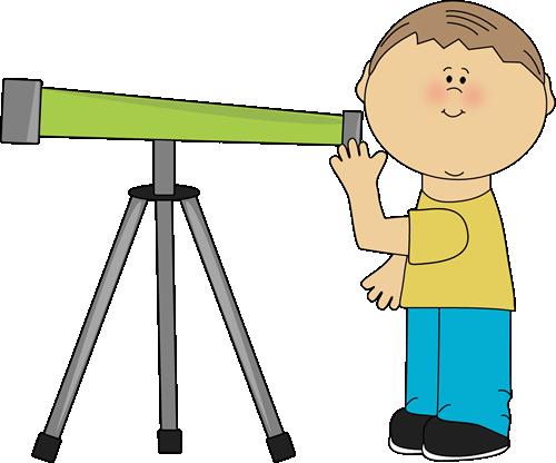 Boy looking through a telescope..
