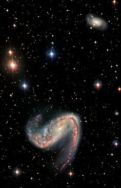 NGC 3314 is a pair of overlapping spiral galaxies between 117.