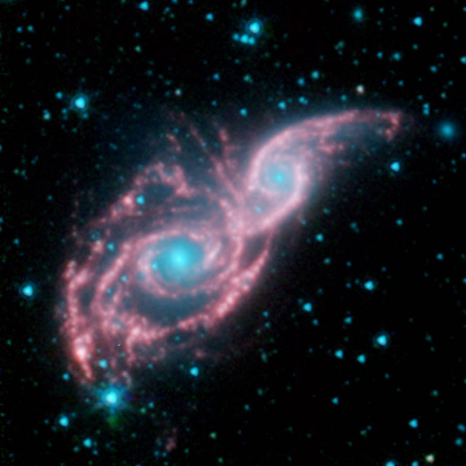 NGC 2207 and IC 2163 Revealed by Spitzer.