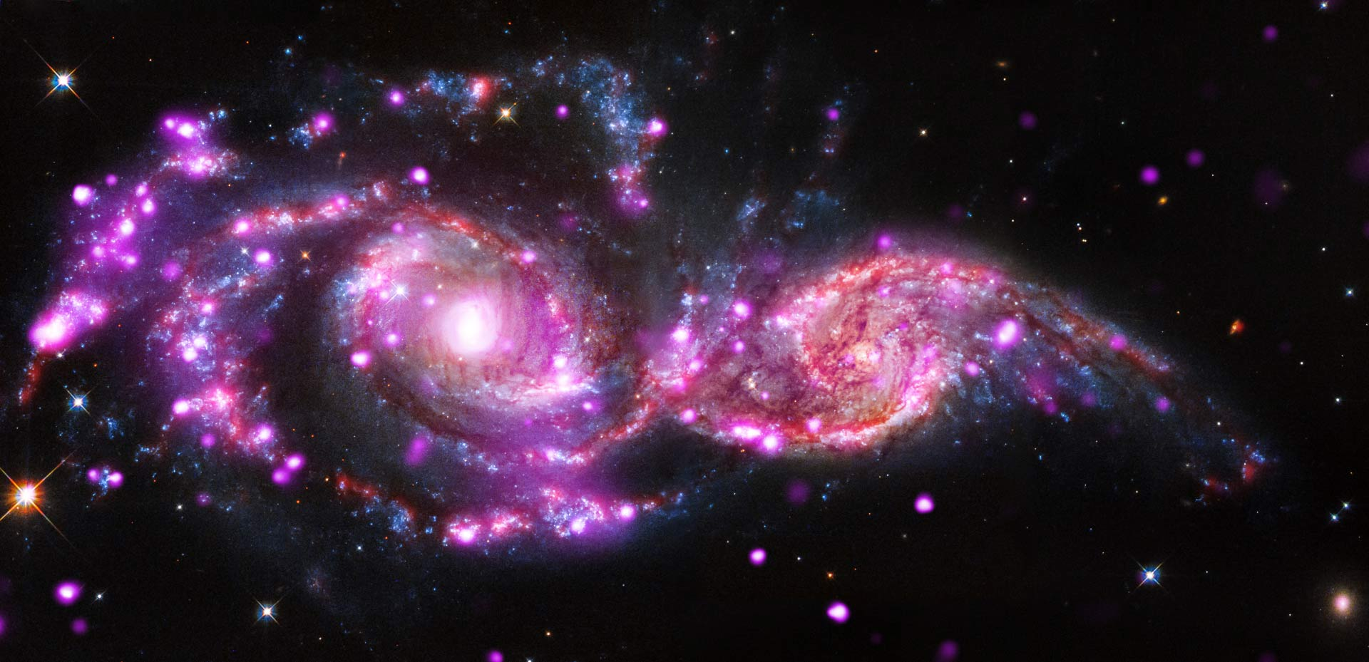 Space Observatories Zero in on Colliding Galaxy Pair NGC 2207.