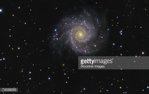 Messier 74 Also Known As Ngc 628 Is A Faceon Spiral Galaxy In The.