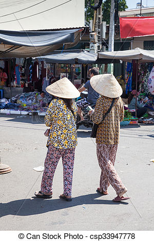 Picture of Vietnamese women in traditional conical hat sell.