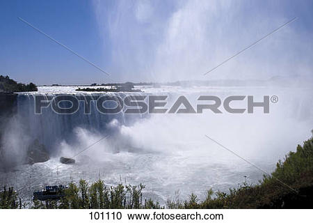 Stock Photography of Water falling into river, Niagara Falls.