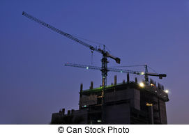 Stock Photographs of crane loader at night construction site.