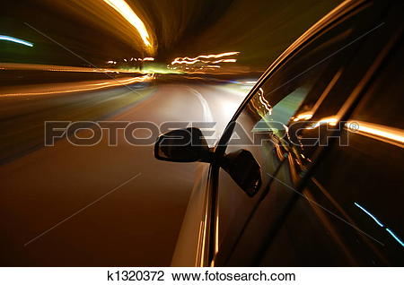 Stock Photo of night drive with car in motion k1320372.