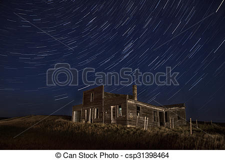 Stock Image of Star Trails Night Photography Abandoned Building.