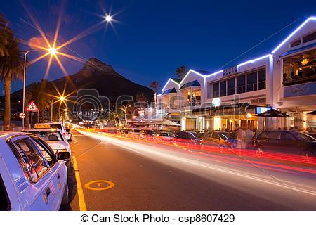 Stock Photographs of Night shot of Capms Bay street with Mountains.