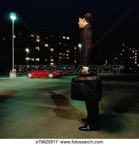 Picture of Businessman in parking lot, night, side view x75625917.