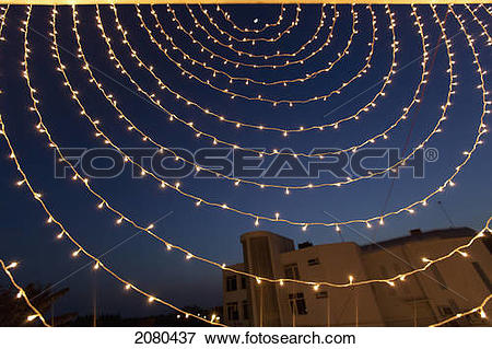 Picture of Small white lights strung in a circular pattern against.