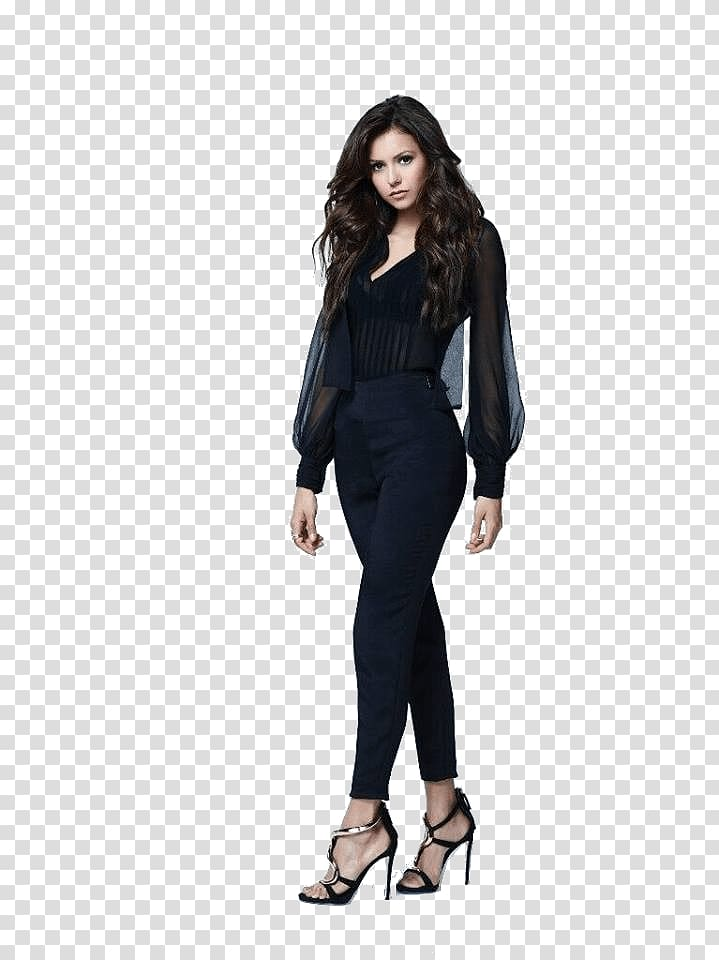 Woman wearing black jumpsuit, Nina Dobrev Standing.
