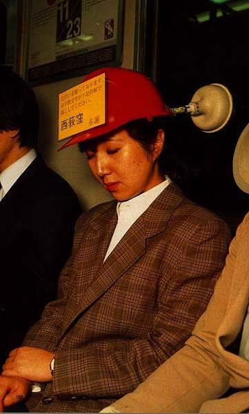 """Japanese silly invention 3. The sign says """"please wake me up at."""
