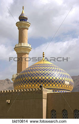 Stock Photo of Oman fort in Nizwa with minaret the sultan Qaboos.