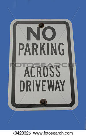 Stock Image of no parking across driveway sign k0423325.