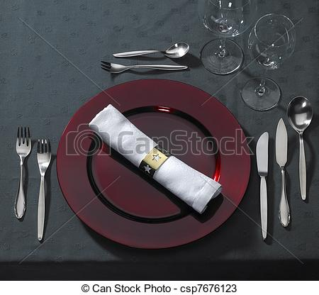 Stock Photos of noble place setting on dark tablecloth.