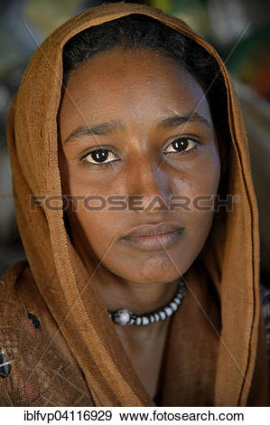 Stock Photograph of Young girl from a nomadic tribe, wearing.