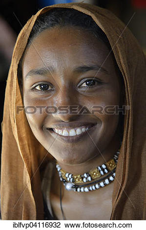 Stock Photo of Young girl from a nomadic tribe, wearing headgear.