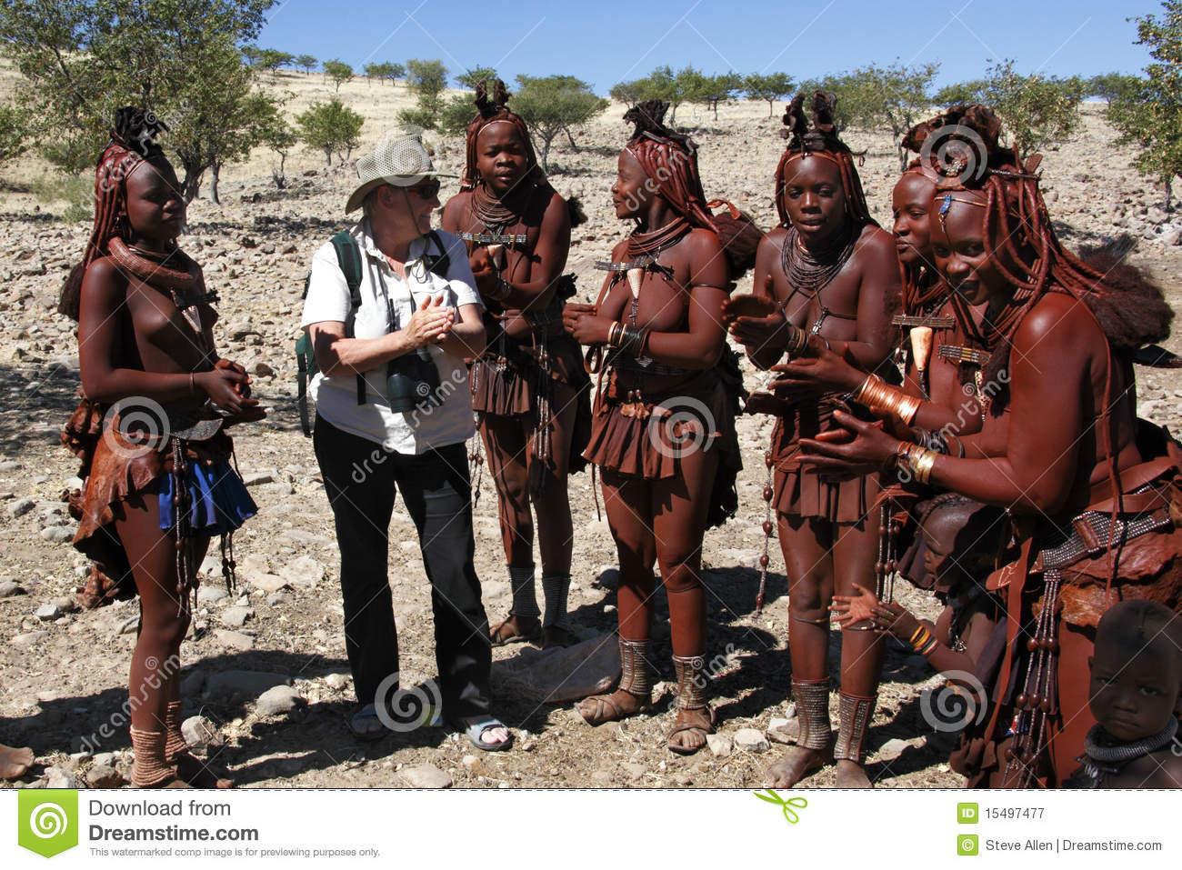Tourist And Himba Nomadic Tribe.