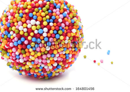 A Ball Coated With Nonpareils Of Different Colors On A White.