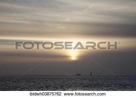 "Stock Photo of ""Dark clouds above the North Sea island of."