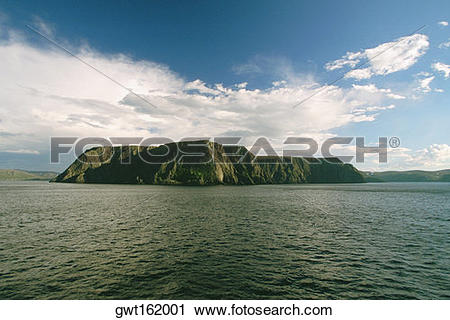 Stock Photography of Clouds over a cliff at the waterfront, North.