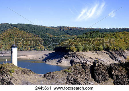 Stock Photography of Lighthouse and lake with forest in background.