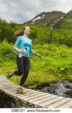 Stock Photography of Woman hiking/running on North Face Trail to.