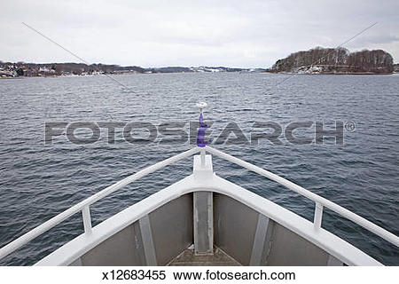 Stock Image of Boat prow approaching islands in the North Sea.