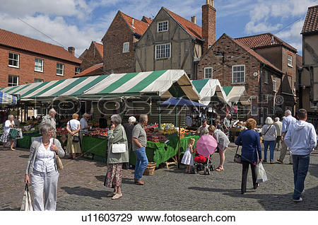 Stock Photograph of England, North Yorkshire, York. People buying.