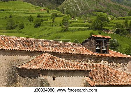Pictures of Pantiled roofs and church belfry in Carmona, Cantabria.